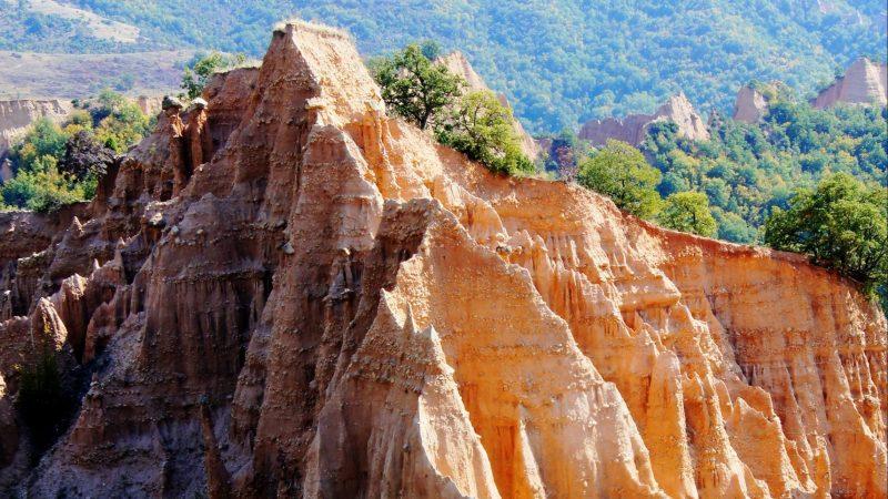 earth pyramids, mountains, orange-green shades, spectral, photo from above